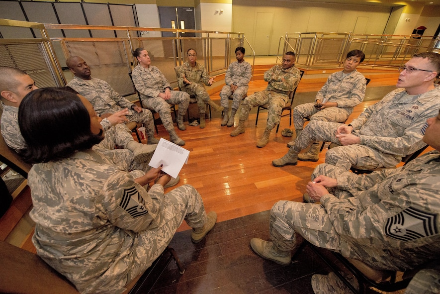 Members of team Osan discuss equality and diversity in a group setting during a women's empowerment forum at Osan Air Base, Republic of Korea, Feb. 22, 2017. The next Osan meeting will be held March 29, 2017 at the Enlisted Club. (U.S. Air Force photo by Airman 1st Class Gwendalyn Smith)