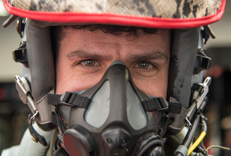 U.S. Air Force Capt. Jason Markzon, a 13th Fighter Squadron pilot, tests his MBU 20/P breathing mask at Misawa Air Base, Japan, Feb. 8, 2017. Before take-off, a preflight check is performed by aircrew flight equipments Airmen, ensuring all equipment functions properly. (U.S. Air Force photo by Airman 1st Class Sadie Colbert)