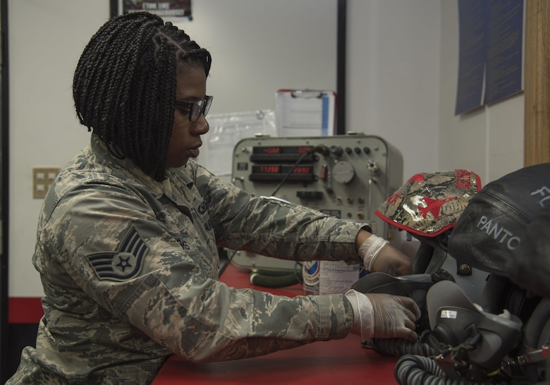 U.S. Air Force Staff Sgt. Faitha Brookins, the 35th Operations Support Squadron aircrew flight equipment NCO in charge, cleans a joint mounted cueing system helmet at Misawa Air Base, Japan, Feb. 8, 2017. Every day the AFE shop maintains the cleanliness and functionality of the pilot's equipment while performing thorough routine checks during their shift. (U.S. Air Force photo by Airman 1st Class Sadie Colbert)