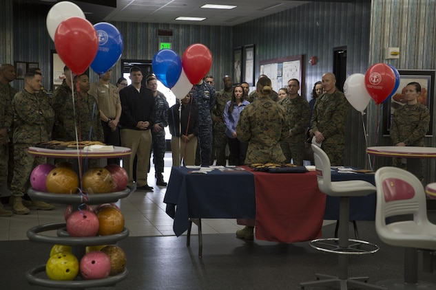 U.S. Marine Corps 1st Lt. Melissa Heisterberg, lead coordinator of the Active-Duty Fund Drive in support of the Navy-Marine Corps Relief Society, speaks to Marines and Sailors about the NMCRS during the drive's kickoff at the Strike Zone Bowling Center at Marine Corps Air Station Iwakuni, Japan, Feb. 24, 2017. The NMCRS is a non-profit organization whose long-term mission is to help service members become financially self-sufficient by teaching them to manage their personal finances and prepare for unplanned expenditures. (U.S. Marine Corps photo by Lance Cpl. Carlos Jimenez)