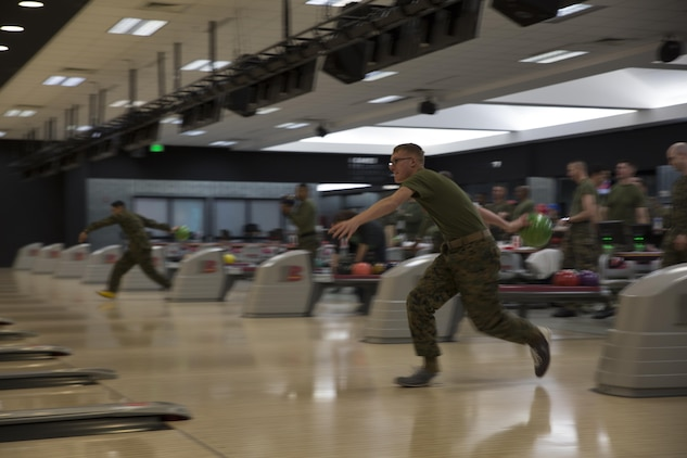 U.S. Marine Corps Lance Cpl. Daniel Sorrells, an individual material readiness list manager with Marine Aviation Logistics Squadron (MALS) 12, bowls during the Active-Duty Fund Drive kickoff in support of the Navy-Marine Corps Relief Society at the Strike Zone Bowling Center at Marine Corps Air Station Iwakuni, Japan, Feb. 24, 2017.  The NMCRS is a non-profit organization whose long-term mission is to help service members become financially self-sufficient by teaching them to manage their personal finances and prepare for unplanned expenditures. (U.S. Marine Corps photo by Lance Cpl. Carlos Jimenez)