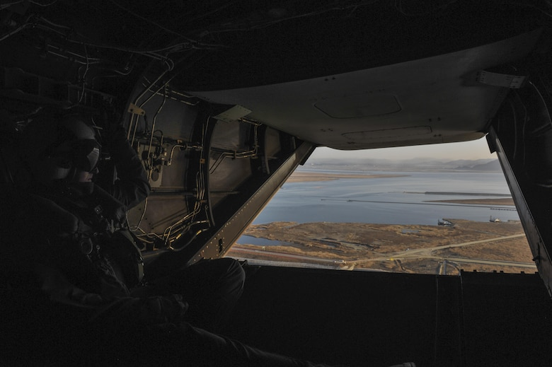 U.S. Marine Corps Cpl. Tyler Gartin, an MV-22 Osprey tiltrotor crew chief assigned to Marine Medium Tiltrotor Squadron (VMM) 265, surveys the area below before it lands at Kunsan Air Base, Republic of Korea, Feb. 2, 2017. Gartin's responsibilities include assisting the pilot by monitoring the area for debris and other aircraft during landing. (U.S. Air Force photo by Senior Airman Colville R. McFee)