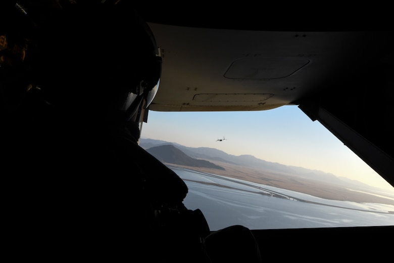 U.S. Marine Corps Cpl. Tyler Gartin, an MV-22 Osprey tiltrotor crew chief assigned to Marine Medium Tiltrotor Squadron (VMM) 265, monitors the location of a MV-22 Osprey during flight over Kunsan Air Base, Republic of Korea, Feb. 2, 2017. Gartin provided visual aid to the pilot who cannot see out of the rear of the aircraft. . (U.S. Air Force photo by Senior Airman Michael Hunsaker)