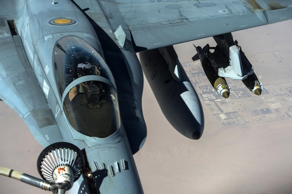 An Australian air force F/A-18 Super Hornet refuels from a U.S. Air Force KC-135 Stratotanker supporting Operation Inherent Resolve, Feb. 22, 2017. Air Force photo by Staff Sgt. Matthew B. Fredericks