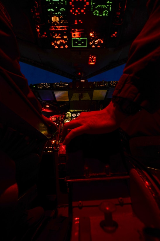 U.S. Air Force Capt. Andrew Kim, right, 351st Air Refueling Squadron co-pilot, adjusts the controls of a KC-135 Stratotanker Feb. 20, 2017, over France. The KC-135's primary functions are aerial refueling and airlift. The aircraft is capable of holding up to 200,000 pounds of transferable fuel. (U.S. Air Force photo by Staff Sgt. Micaiah Anthony)