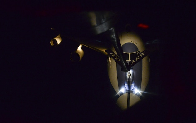 A U.S. Air Force KC-135 Stratotanker assigned to the 100th Air Refueling Wing passes fuel to a U.S. Air Force E-4B transporting the U.S. Secretary of Defense Feb. 20, 2017. The E-4B is protected against the effects of electromagnetic pulse and has an electrical system designed to support advanced electronics and a wide variety of communications equipment. An advanced satellite communications system provides worldwide communication for senior leaders through the airborne operations center. Other improvements include nuclear and thermal effects shielding, acoustic control, an improved technical control facility and an upgraded air-conditioning system for cooling electrical components. (U.S. Air Force photo by Staff Sgt. Micaiah Anthony)