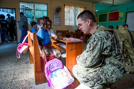 TRUJILLO, Honduras (Feb. 24, 2017) – Hospital Corpsman 1st Class Sean Mckay, a native of Bozeman, Mont., assigned to Navy Environmental and Preventative Medicine Unit (NEPMU) 2, Norfolk, Va., speaks with host nation school children during a preventative medicine site visit in support of Continuing Promise 2017's (CP-17) stop in Trujillo, Honduras. CP-17 is a U.S. Southern Command-sponsored and U.S. Naval Forces Southern Command/U.S. 4th Fleet-conducted deployment to conduct civil-military operations including humanitarian assistance, training engagements, and medical, dental, and veterinary support in an effort to show U.S. support and commitment to Central and South America. (U.S. Navy photo by Mass Communication Specialist 2nd Class Shamira Purifoy)