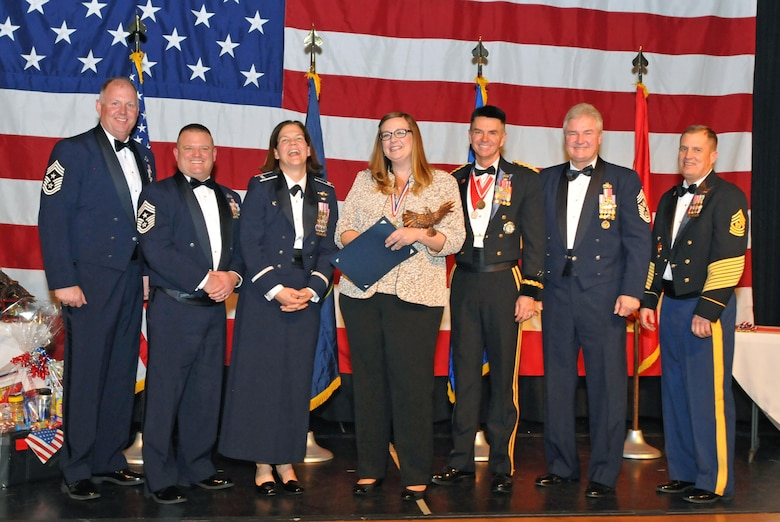 Ms. Jackie Ezell with the 151st Mission Support Group accepts her award for Civilian of the Year during the Utah Air National Guard 2016 Airman of the Year awards banquet held at the Utah Cultural Center in West Valley, Utah on Jan. 21, 2017. (U.S. Air National Guard photo by Tech. Sgt. Annie Edwards)