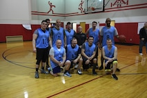 Members of the 911th Maintenance Group pose for a team photo after the final game of the 911th Airlift Wing Basketball Tournament at the Pittsburgh International Airport Air Reserve Station, Feb. 11, 2017. The 911th MXG team won second place, losing the final game to the defending victor, the 911th Aeromedical Staging Squadron. (U.S. Air Force photo by Staff Sgt. Marjorie A. Bowlden)