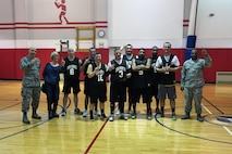 Members of the 911th Aeromedical Staging Squadron, including squadron commander Col. Sharon Colaizzi, pose for a team photo after the final game of the 911th Airlift Wing Basketball Tournament at the Pittsburgh International Airport Air Reserve Station, Feb. 11, 2017. This is the second championship in a row for the 911th ASTS. (U.S. Air Force photo by Staff Sgt. Marjorie A. Bowlden)