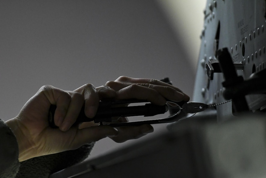 A weapons load crew member assigned to the 25th Maintenance Unit secures a wire while preparing an A-10 Thunderbolt II for a mission during Exercise Beverly Herd 17-1, Feb. 27, 2017, at Osan Air Base, Republic of Korea. Airmen assigned to the 51st Maintenance Group were responsible for quickly spinning up aircraft and preparing them for missions with limited-to-no notice. (U.S. Air Force photo by Staff Sgt. Victor J. Caputo)