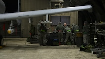 Airmen assigned to the 51st Maintenance Group discuss working orders Feb. 27, 2017, during Exercise Beverly Herd 17-1 at Osan Air Base, Republic of Korea. Exercise BH 17-1 tested the 51st Maintenance Group's capability to quickly generate airpower for missions. (U.S. Air Force photo by Staff Sgt. Victor J. Caputo)
