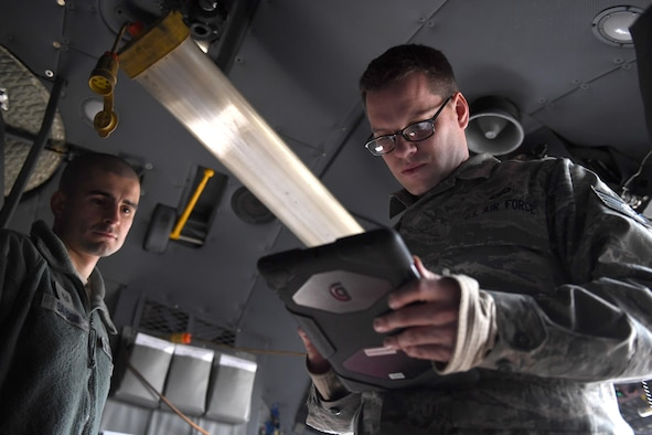 Tech. Sgt. Benjamin Sardon and Staff Sgt. Jacob Liebel, communication and navigation systems technicians with the 911th Aircraft Maintenance Squadron, perform a functional check on the Real Time In Cockpit modification at the Pittsburgh International Airport Air Reserve Station, Feb. 8, 2017. RTIC was installed in five of the eight C-130 Hercules aircraft assigned to the 911th Airlift Wing to improve situational awareness of pilots. (U.S. Air Force photo by Staff Sgt. Marjorie A. Bowlden)