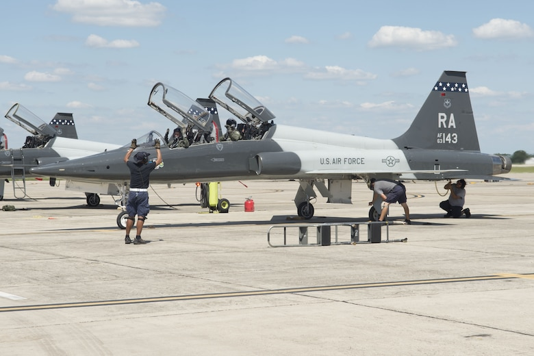 A 12th Maintenance Directorate crew chief and maintainers recover a T-38C Talon after a training mission at Joint Base San Antonio-Randolph, Texas. (Courtesy Photo)
