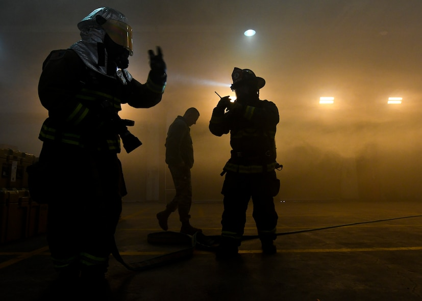 Firefighters from the 51st Civil Engineering Squadron respond to a simulated warehouse fire during Exercise Beverly Herd 17-1, Feb. 27, 2017, at Osan Air Base, Republic of Korea. The simulation was executed to better equip members of Team Osan with the knowledge and experience to carry out and sustain the mission and operations with our Republic of Korea allies.  (U.S. Air Force photo by Airman 1st Class Gwendalyn Smith)