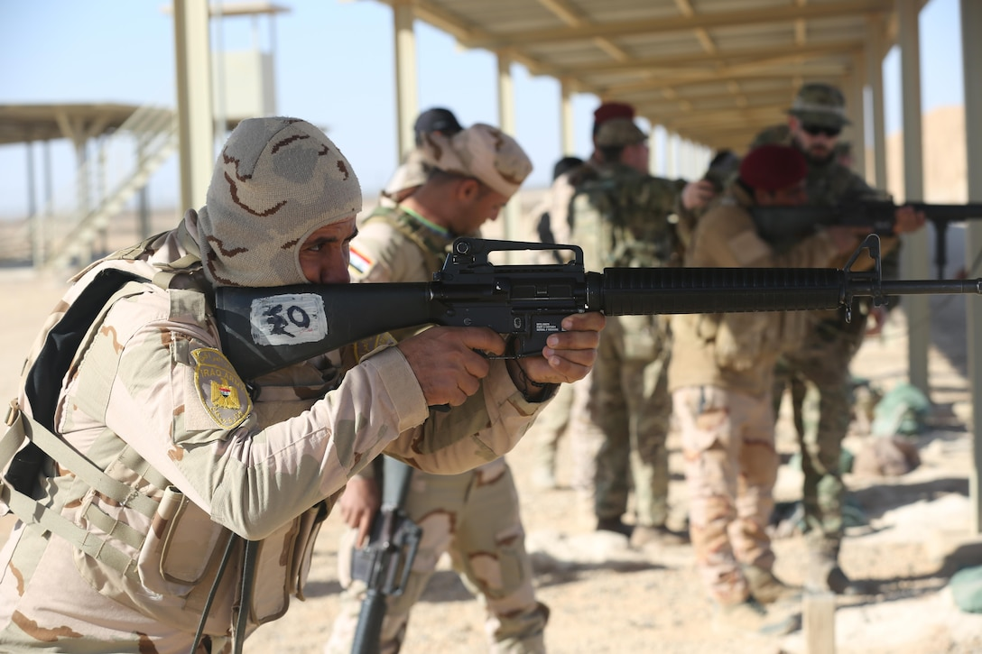 Iraqi security forces soldiers practice the standing position during weapons training at Al Asad Air Base, Iraq, Feb. 23, 2017.  This training is part of the overall Combined Joint Task Force – Operation Inherent Resolve building partner capacity mission to train and improve the capability of partnered forces fighting ISIS. CJTF-OIR is the global Coalition to defeat ISIS in Iraq and Syria. (U.S. Army photo by Sgt. Lisa Soy)