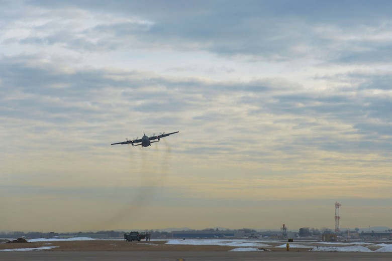 A 103rd Airlift Wing C-130 Hercules, with deploying Airmen on board, takes off from Bradley Air National Guard Base, East Granby, Conn., Feb. 22, 2017. This C-130 is headed to the Middle East in support of deployment operations. (U.S. Air National Guard photo by 2nd Lt. Jen Pierce)