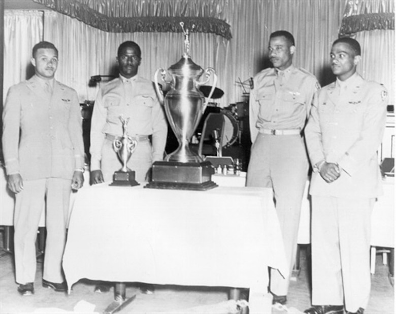 """Capt. Alva Temple, 1st Lt. James Harvey, 1st Lt. Harry Stewart and 1st Lt. Halbert Alexander, the winners of the Air Force's first """"Top Gun"""" competition, pose with the trophy during May of 1949. The trophy went missing for 55 years, but was found at the storage area of the National Museum of the U.S. Air Force at Wright Patterson Air Force Base, Ohio."""