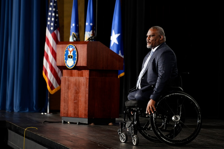 Retired Army Col. Greg Gadson, the keynote speaker for this year's National Character and Leadership Symposium at the U.S. Air Force Academy, speaks from the stage in Arnold Hall, Feb. 23, 2017. Gadson spoke about the value of developing character at the symposium. He lost his legs to a roadside bomb in 2007. (U.S. Air Force photo/Mike Kaplan)