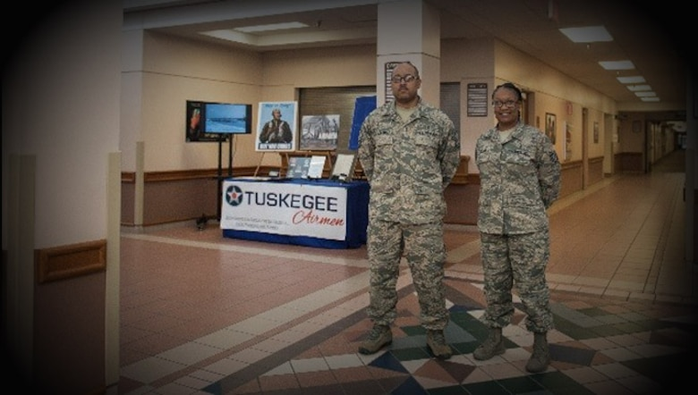 Master Sgt. William Jackson, 27th Special Operations Aerospace Medical Squadron superintendent, and Tech. Sgt. Anssa Knight, 27th Special Operations Medical Support Squadron NCO in charge of diagnostic imaging, pose in front of a display commemorating Black History Month Feb. 2, 2017 at Cannon Air Force Base, N.M. Jackson and Knight gave their own money and time to achieve their vision of creating education-focused displays and programming honoring Black History Month. (U.S. Air Force Photo by Senior Airman Shelby Kay-Fantozzi/released)