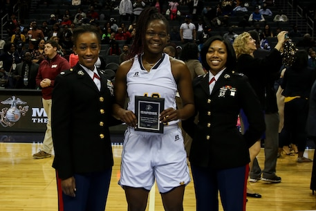 Lieutenant Col. Marshalee E. Clarke, congressional liaison for the Office of The Assistant Secretary, left, and Capt. Joanna Reynolds, the regional advertising officer for 6th Marine Corps District, present the Marine Corps Excellence in Leadership Award to Blaire Thomas of Johnson C. Smith University following the women's semifinals game of the Central Intercollegiate Athletic Association (CIAA) championships at the Spectrum Center in Charlotte, N.C., Feb. 25, 2017.  Johnson C. Smith University defeated Virginia State University 68 to 59. The Marines are present at the Central Intercollegiate Athletic Association championships to spread awareness to student athletes and fans about career and educational opportunities in the Marine Corps. (U.S. Marine Corps photo by Lance Cpl. Jack A. E. Rigsby/Released)