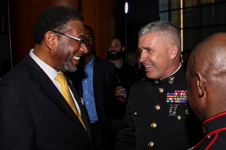 Major General Paul J. Kennedy, Commanding General of Marine Corps Recruiting Command, speaks to Dr. Ronald L. Carter, president of Johnson C. Smith University, during the Central Intercollegiate Athletic Association (CIAA) President's Dinner at the Spectrum Center in Charlotte, N.C., Feb. 24, 2017. The Marines take part in the President's Dinner at the CIAA to help spread awareness and inform others of educational and career opportunities that the Marine Corps can provide. The President's Dinner assists recruiters by offering them different tools to reach students across the state. (U.S. Marine Corps photo by Lance Cpl. Jack A. E. Rigsby/Released)