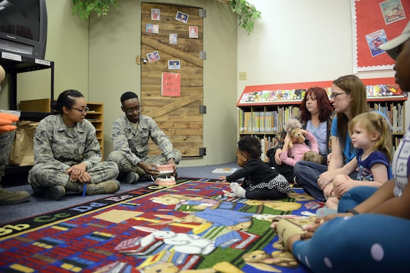 56th Dental Squadron Airmen show children how to properly brush their teeth during their visit to the base library at Luke Air Force Base, Ariz., Feb. 15, 2017.The 56th Dental Squadron is celebrating National Children's Dental Health Month and wants to educate parents on how to care for their children's teeth. (U.S. Air Force photo by Senior Airman Devante Williams)