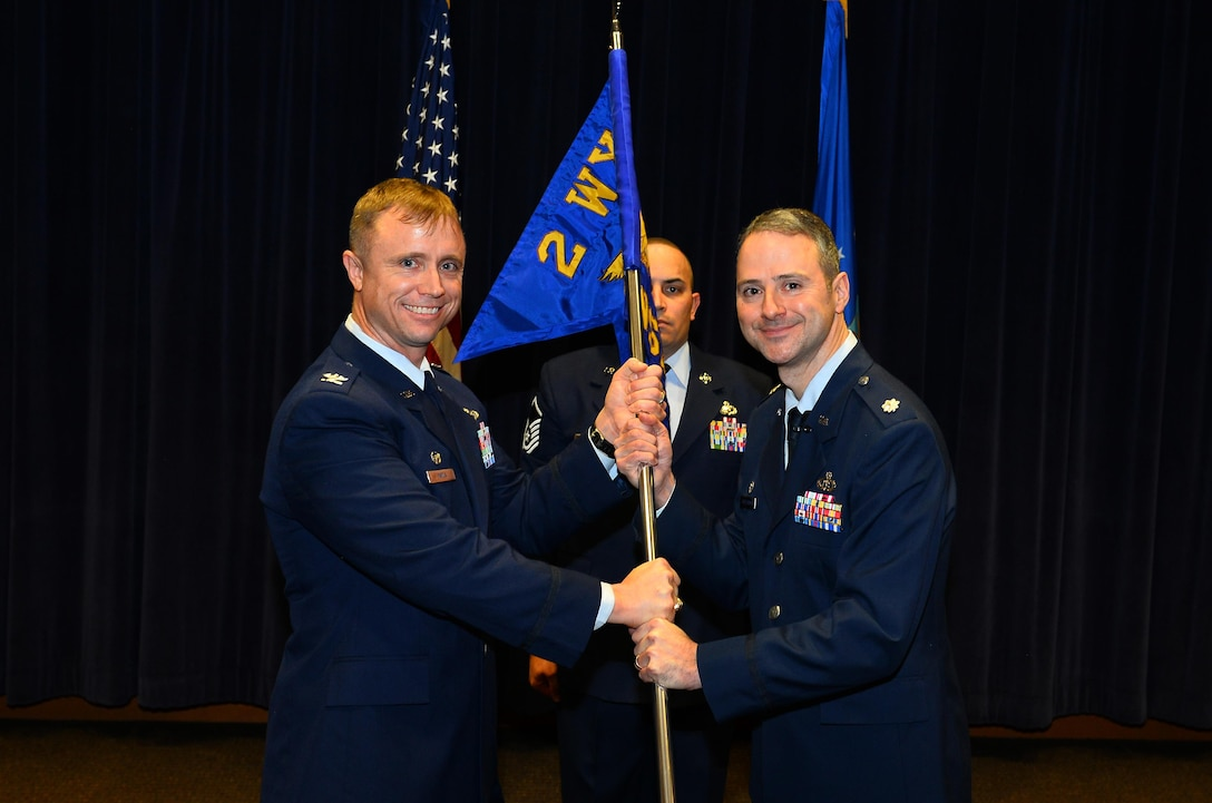 Lt. Col. Hugh J. Freestrom, 2d Weather Support Squadron commander, accepts the command guidon from Col. Jason E. Patla, 2d Weather Group commander, as he assumes command of the newly-formed 2d WSS during a ceremony at the 557th Weather Wing headquarters, Offutt Air Force Base Neb., Feb. 17, 2017. The 2d WSS, formerly Detachment 1, is comprised of three main flights; the commander's support staff, operations and cyberspace operations. (U.S. Air Force photo by Josh Plueger)