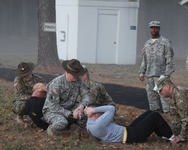 Army Reserve Soldiers from the 310th Sustainment Command (Expeditionary), headquartered in Indianapolis, Ind., perform sit-ups during the Army Physical Fitness Test as part of the 2017 310th ESC Best Warrior Competition, held at Ft. A.P. Hill, Va., Feb. 23 - 28.  The annual six day competition tests enlisted Soldiers and noncommissioned officers in their ability to perform Army Warrior tasks in a variety of events leading to the 377th Theater Sustainment Command's competition, which is a feed to the U.S. Army Reserve Command Best Warrior.