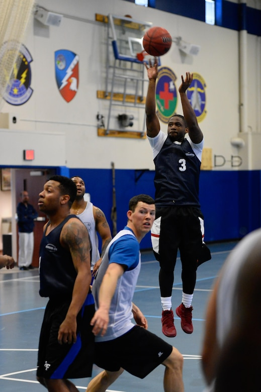 Henriksen Liberis, 4th Space Operations Squadron, puts up a jump shot during the intramural basketball championship game at Schriever Air Force Base, Colorado, Thursday, Feb. 23, 2017. Liberis scored 11 second-half points to help lead 4 SOPS to the title with a 58-38 win over the U.S. Air Force Warfare Center. (U.S. Air Force photo/Christopher DeWitt)