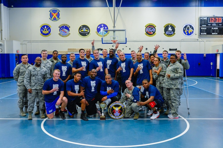 4th Space Operations Squadron members celebrate following their 58-38 win over the U.S. Air Force Warfare Center in the intramural basketball championship game at Schriever Air Force Base, Colorado, Thursday, Feb. 23, 2017. 4 SOPS earned the title and redemption for a loss to USAFWC in the 2016 championship game. (U.S. Air Force photo/Christopher DeWitt)