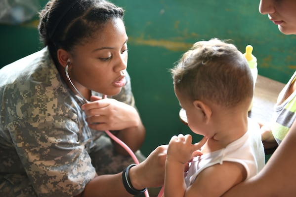 U.S. Army Spc. Gloria Galbearth, Joint Task Force-Bravo Medical Element, checks a child's vital signs during a Medical Readiness Training Exercise in Corinto, Cortes, Feb. 16, 2017. Galbearth was assigned to the filtering section of the MEDRETE where patients were examined prior to seeing a provider. (U.S. Army photo by Maria Pinel)