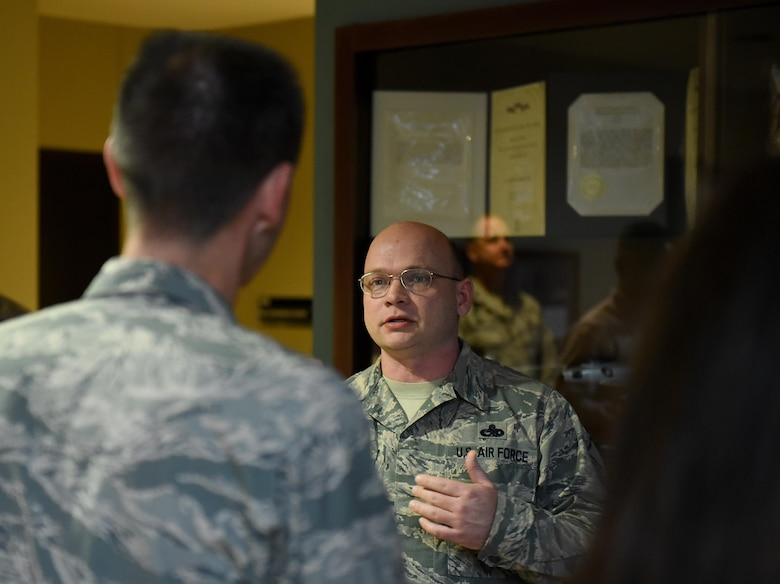 U.S. Air Force Master Sgt. Christopher Murdock (right), 4th Maintenance Group development and instruction section chief, speaks to Maj. Gen. Scott Zobrist, 9th Air Force commander, about the Make It Better computer  club at Seymour Johnson Air Force Base, N.C., Feb. 15, 2017. The Make It Better initiative began in 2014 and encourages members with similar interests and hobbies to join forces to improve morale and camaraderie of Team Seymour Airmen and families. (U.S. Air Force photo by Airman 1st Class Kenneth Boyton)