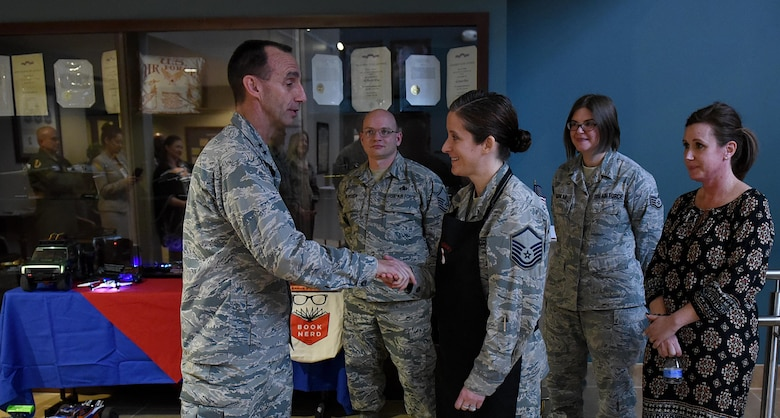 U.S. Air Force Maj. Gen. Scott Zobrist (left), 9th Air Force commander, coins Master Sgt. Katie Neeley, 4th Aerospace Medicine Squadron superintendent at Seymour Johnson Air Force Base, N.C., Feb. 15, 2017. Neeley is the president of the Make It Better culinary club. (U.S. Air Force photo by Airman 1st Class Kenneth Boyton)