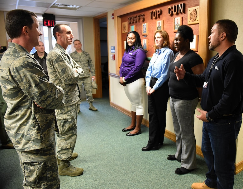 U.S. Air Force Col. Christopher Sage (far left), 4th Fighter Wing commander, and Maj. Gen. Scott Zobrist, 9th Air Force commander, speak with contractors during a base visit at Seymour Johnson Air Force Base, N.C., Feb. 15, 2017. Zobrist said contract employees are vital to helping the Air Force mission run smoothly. (U.S. Air Force photo by Airman 1st Class Kenneth Boyton)