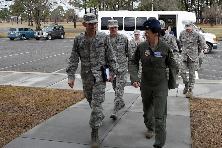 Members of 9th Air Force and Team Seymour leadership walk to the newly built 4th Operations Support Squadron Weapons and Tactics Razor Talon War Room at Seymour Johnson Air Force Base, N.C., Feb. 15, 2017. The War Room will enhance communications and other capabilities during future exercises such as Razor Talon an exercise that began in 2013 and was developed at Seymour Johnson AFB to combine land, air and sea forces for joint unit participation and collaboration. (U.S. Air Force photo by Airman 1st Class Kenneth Boyton)