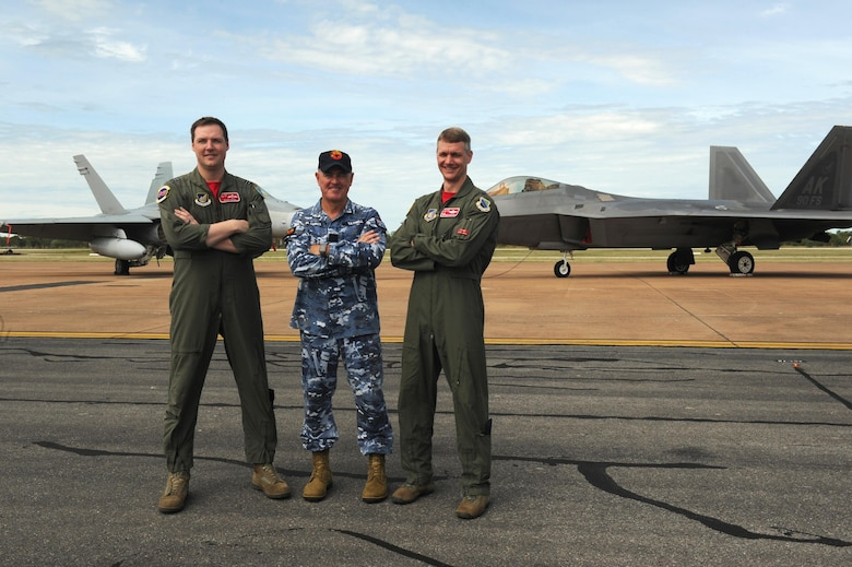 From left: Royal Australian Air Force Flight Lieutenant William Grady, 90th Fighter Squadron exchange pilot; Wing Commander Andrew Tatnell, RAAF Base Tindal Senior Australian Defence Force Officer; and U.S. Air Force Lt. Col. David Skalicky, 90th FS commander, pose for a photo in front of a RAAF 75 Squadron F/A-18A/B Hornet and U.S. 90th FS F-22 Raptor at RAAF Base Tindal, Australia, Feb. 24, 2017. Twelve F-22 Raptors and approximately 200 U.S. Air Force Airmen are in Australia as part of the Enhanced Air Cooperation, an initiative under the Force Posture Agreement between the U.S. and Australia. (U.S. Air Force photo by Staff Sgt. Alexander Martinez)