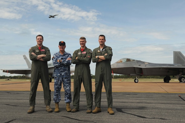 From left: Royal Australian Air Force Flight Lieutenant William Grady, 90th Fighter Squadron exchange pilot; Wing Commander Andrew Tatnell, RAAF Base Tindal Senior Australian Defence Force Officer; U.S. Air Force Lt. Col. David Skalicky, 90th FS commander; and Wing Commander Mick Grant, 75 Squadron commander pose for a photo in front of a RAAF 75 SQ F/A-18A/B Hornet and U.S. 90th FS F-22 Raptor at RAAF Base Tindal, Australia, Feb. 24, 2017. Twelve F-22 Raptors and approximately 200 U.S. Air Force Airmen are in Australia as part of the Enhanced Air Cooperation, an initiative under the Force Posture Agreement between the U.S. and Australia. (U.S. Air Force photo by Staff Sgt. Alexander Martinez)