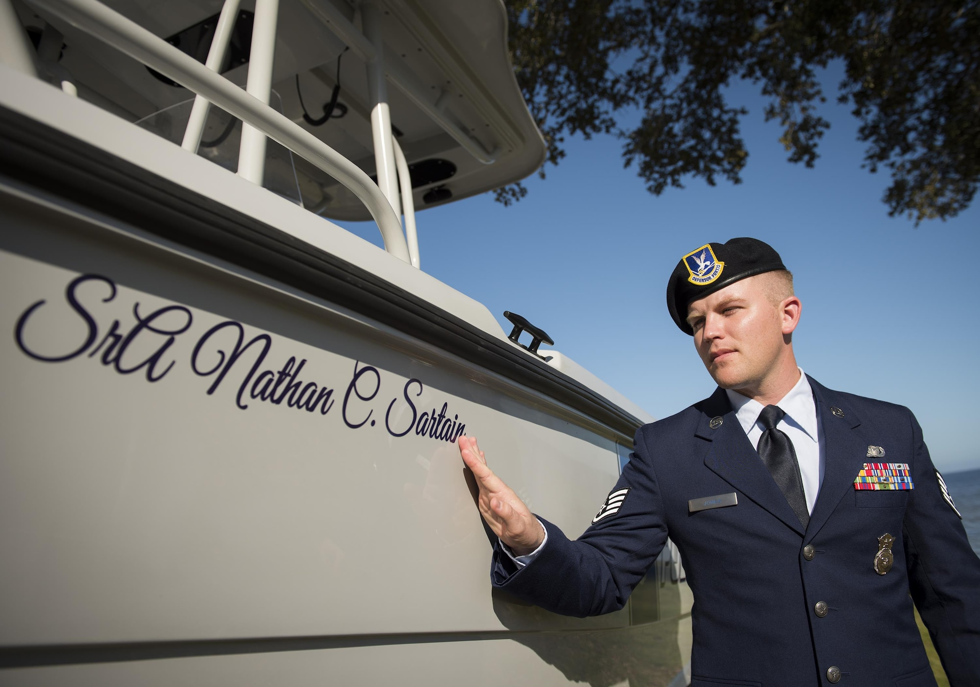 Staff Sgt. Travis Jones, 96th Security Forces Squadron, remembers his friend, Senior Airman Nathan Sartain, during a boat-dedication ceremony Feb. 24 at Eglin Air Force Base, Fla.  Sartain, a security forces Airman from Pensacola, died in an aircraft crash while deployed in 2015.  The newest patrol boat in the Eglin fleet bears his name to honor his service and sacrifice. (U.S. Air Force photo/Samuel King Jr.)