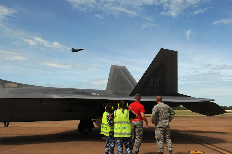 U.S. and Royal Australian Air Force maintenance airmen watch as an F-22 Raptor takes off at RAAF Base Tindal, Australia, Feb. 24, 2017. Twelve F-22 Raptors and approximately 200 U.S. Air Force Airmen are in Australia as part of the Enhanced Air Cooperation, an initiative under the Force Posture Agreement between the U.S. and Australia. (U.S. Air Force photo by Staff Sgt. Alexander Martinez)