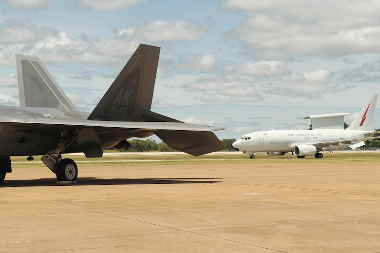 A Royal Australian Air Force E-7A Wedgetail taxies past a U.S. Air Force 90th Fighter Squadron F-22 Raptor at RAAF Base Tindal, Australia, Feb. 24, 2017. Twelve F-22 Raptors and approximately 200 U.S. Air Force Airmen are in Australia as part of the Enhanced Air Cooperation, an initiative under the Force Posture Agreement between the U.S. and Australia. (U.S. Air Force photo by Staff Sgt. Alexander Martinez)