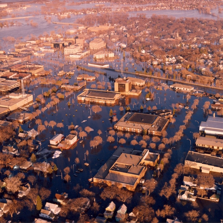 Aerial photo of downtown Grand Forks, North Dakota/East Grand Forks, Minnesota, taken April 20, 1997, after the cities were inundated. --USACE St. Paul District file photo