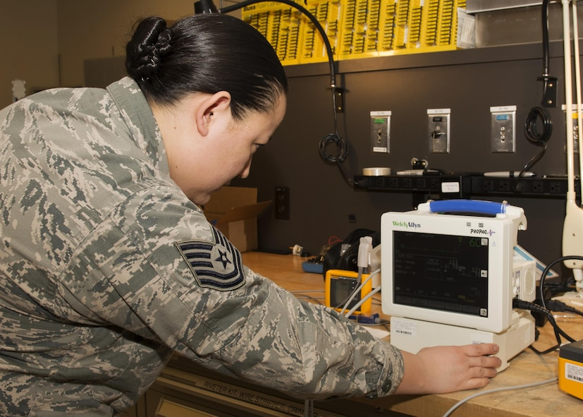 Tech. Sgt. Linsey McCluskey, 5th Medical Support Squadron medical maintenance NCO-in-charge, tests a vital signs monitor for accuracy at the 5th Medical Group clinic at Minot Air Force Base, N.D., Feb. 8, 2017. The monitor is used in almost every appointment made on base to check the heart rate, blood pressure and temperature of a patient. (U.S. Air Force photo/Airman 1st Class Alyssa M. Akers)
