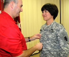 Army Reserve Brig. Gen. Miyako Schanely, deputy commander, 412th Theater Engineer Command, is pinned her one star by her husband, Steve, in a ceremony held at the TEC's headquarters in Vicksburg, Miss. Schanely, a resident of Black River, N.Y., is the first female Japanese-American and the first female Engineer in the Army Reserve and second in the Army to be promoted to General Officer.