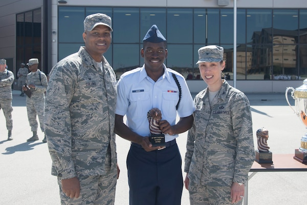 The trophy for third place in the 37th Training Wing Drill Down Competition is awarded to a representative for the 343rd Training Squadron drill team, by Col. Roy Collins, 37th TRW commander, and Col. Bridget Gigliotti, 37th Training Group commander, at the Pfingston Reception Center at Joint Base San Antonio-Lackland, Texas Feb 25, 2017. The 343rd TRS provides training to Air Force security forces personnel.