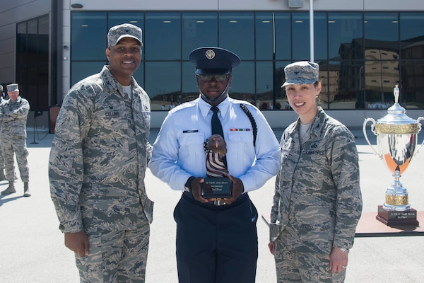 The trophy for second place in the 37th Training Wing Drill Down invitational is awarded to a representative from the 17th Training Wing drill team, by Col. Roy W. Collins, 37th TRW commander, and Col. Bridget Gigliotti, 37th Training Group commander, at the Pfingston Reception Center at Joint Base San Antonio-Lackland, Texas, Feb. 25, 2017. The 17th TRW team traveled from Goodfellow Air Force Base, Texas, to participate in the competition for the first time.