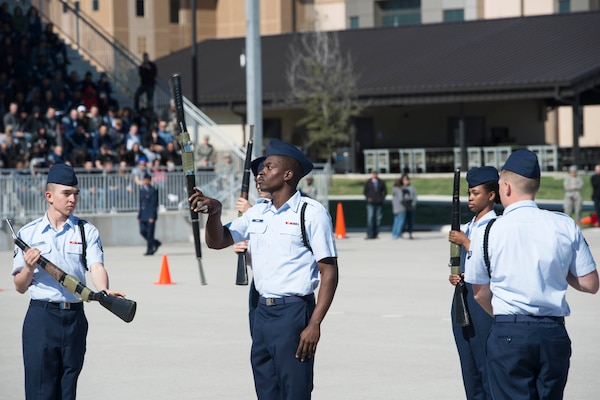 Members of the 343rd Training Squadron drill team perform drill movements in the regulation round of the 37th Training Wing Drill Down Invitational at the Pfingston Reception Center at Joint Base San Antonio-Lackland, Texas, Feb 25, 2017. The competition consisted of an open ranks inspection, a regulation drill performance and a freestyle drill performance from each team.