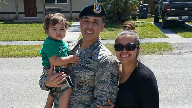 Tech. Sgt. Jose Rosado, assigned to the 482nd Security Forces Squadron, Homestead Air Reserve Base, Fla., stands with mother Janelly Rivera and baby Rivera after he saved their lives when their car went into a canal along with father John Rivera on Jan. 29, 2016. (U.S. Air Force photo/Senior Airman Aja Heidan)