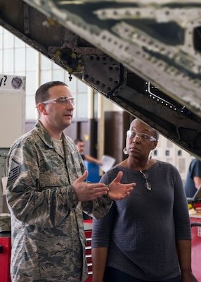Master Sgt. Ryan Love (left), Air Education and Training Command equipment manager, speaks with Sharon Walker, 502nd Logistics Readiness Squadron equipment accountability element technician, as work is completed on a T-38 C Talon II Feb. 27 at Joint Base San Antonio-Randolph. Love recently won the AETC Outstanding Air Force Logistics Readiness Enlisted Staff of the Year award. (U.S. Air Force photo by Airman 1st Class Lauren Parsons/Released)