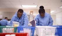 Senior Airman Juron Woods, a 959th Clinical Support Squadron histology technician, and Airman 1st Class Thiouny Samba, a student assigned to the 382nd Training Squadron, sort through patient samples at the San Antonio Military Medical Center, Joint Base San Antonio-Fort Sam Houston, Jan. 13, 2017.  The pathology lab is part of the 959th Medical Group, one of seven groups in the 59th Medical Wing headquartered at Joint Base San Antonio-Lackland, Texas. (U.S. Air Force photo/Staff Sgt. Jerilyn Quintanilla)
